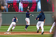 Minnesota Twins center fielder Denard Span eludes his teammates while celebrating a walk off victory against the Milwaukee Brewers in the 15th inning at Target Field in Minneapolis, Minnesota on June 17, 2012.  The Twins defeated the Brewers 5 to 4.  The game was the longest in Target Field history.  © 2012 Ben Krause