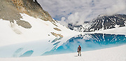 Climber Obadiah Reid walks out to a beautiful blue lake formed from meltwater on Wedgemount Glacier in Garibaldi Provincial Park, British Columbia, Canada on June 14, 2009.