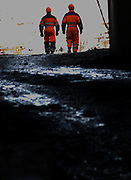 Workers coming out from one of the tunnels in the construction of the Karahnjukar dam. Karahnjukar, Iceland.