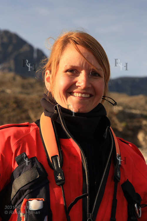 Police officer Cecilie Sørensen of governor's office (Sysselmannen) patrol western coast of Spitsbergen island near Kongsfjorden; Svalbard, Norway.