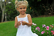 GIRL PLAYING WITH FLOWER, LIFESTYLE, CANDID, FUN , FREESTYLE, ON LOCATION, FRANKLIN TN, NATURE, OUTDOORS, CASUAL,