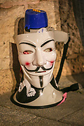 A Guy Fawkes mask hung on a loud speaker (V for Vendetta), as Anti-Netanyahu protesters demonstrate in front of the Prime Minister official residence at Balfur Street, Jerusalem, Israel, April 03, 2021. The Evidence stage of Israeli Prime Minister Benjamin Netanyahu's trial will begin April 5, 2021. The PM is charged by the Israeli State Attorney's Office with sections of fraud, bribery, and breach of trust.