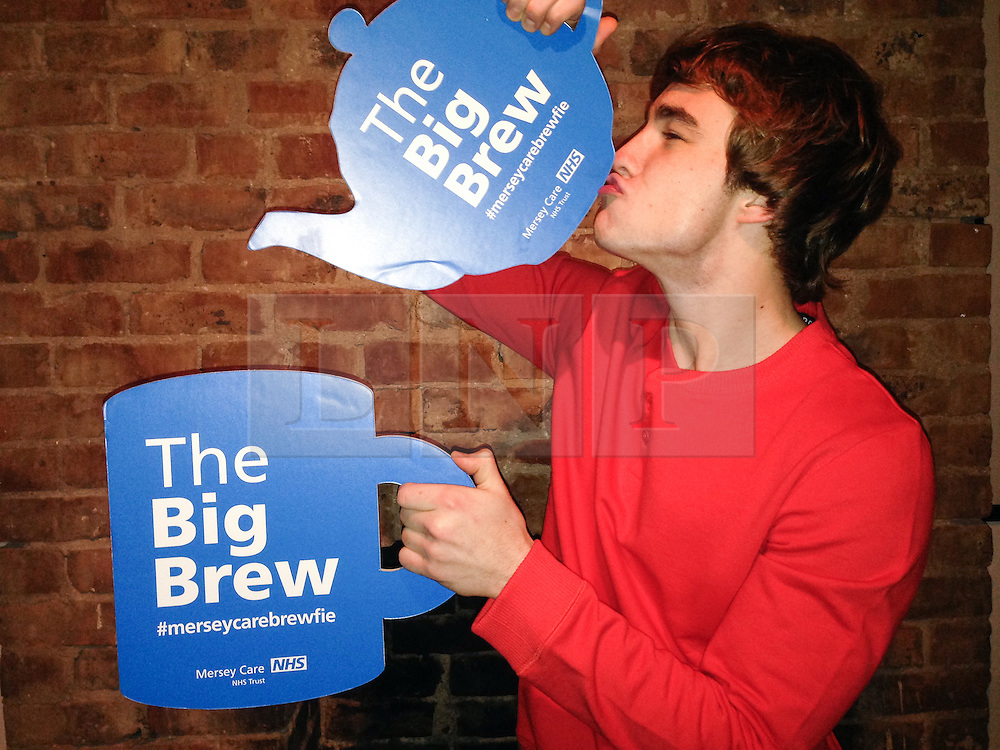 """© Licensed to London News Pictures . 19/01/2015 . Liverpool , UK . Nico Mirallegro from Hollyoaks and My Mad Fat Diary . Celebrities pose with """" Big Brew """" placards in support of mental health awareness as today (19th January 2015) marks """" Blue Monday """" , the day regarded by many as the most depressing in the year . Campaigners are urging the public to show support by tweeting sefies with their favourite brew and the hashtag """" #brewfie """" . In London , Deputy Prime Minister Nick Clegg , is announcing his campaign to improve mental health awareness , reduce stigma and promote a """" zero ambition """" target for suicide . Photo credit : Joel Goodman/LNP"""