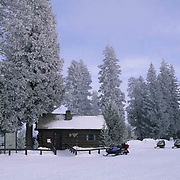 Yellowstone National Park, Snowmobiling in park. Ranger off ice at West Thumb.