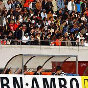 NLD/Amsterdam/20050523 - Voetbal, Suriprofs - Heracles, .reclame, dugout, tribune, publiek, toeschouwers