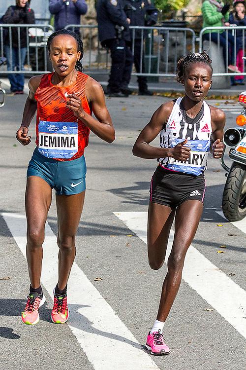 NYC Marathon, Mary Keitany and Jemima Sumgong make their break at mile 22 passing through Marcus Garvey Park in Harlem