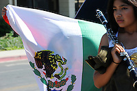 """A young girl plays has fun with a Mexican flag at Sunday's """"El Grito"""" celebration in Salinas marking September 16th's anniversary of Mexico's independence from Spain. The annual fiesta, which occupies East Alisal Street between Wood and Sanborn, brimmed as usual with booths selling patriotic souvenirs and all manner of food and drink. Local businesses and nonprofits manned booths with information about health and community programs, while traditional """"bandas"""" filled the afternoon with dance music and good cheer."""