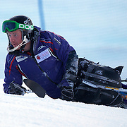 Peter Dunning, Great Britain, slips during course inspection during his third place finish in the Men's Slalom Sitting, Adaptive Slalom competition at Coronet Peak, New Zealand during the Winter Games. Dunning, who lost both his legs in a roadside bombing attack in Afghanistan three years ago. Winter Games, Queenstown, New Zealand, 25th August 2011. Photo Tim Clayton