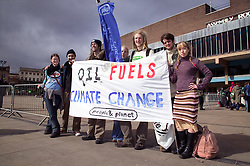 Group of Friends of the Earth supporters staging protest,