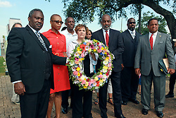 29 August 2013. Lower 9th Ward, New Orleans, Louisiana.<br /> Hurricane Katrina memorial 8 years later. <br /> L/R holding wreath. Local officials, Reverend Willie Calhoun, former councilwoman Cynthia Willard Lewis and Councilman James Gray at the official memorial in remembrance of the day Hirricane Katrina swamped the community.<br /> Photo; Charlie Varley