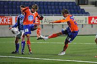 ÅLESUND 20110212. Aalesunds Christian Myklebust (th) setter inn 3-0 under treningskampen i fotball mellom Aalesund og Hødd på Color Line Stadion i Ålesund lørdag ettermiddag. Amund Skiri til venstre.<br /> Foto: Svein Ove Ekornesvåg