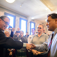 123014       Adron Gardner<br /> <br /> Eleventh Judicial Court Judge Louis DePauli, left,  congratulates Ron Silversmith after swearing him in as as McKinley County Sheriff at the McKinley County Courthouse in Gallup Tuesday.