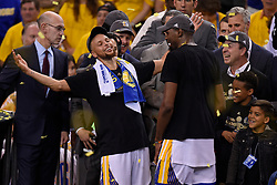 The Golden State Warriors' Stephen Curry, left, celebrates with teammate Kevin Durant on stage after defeating the Cleveland Cavaliers, 129-120, in Game 5 of the NBA Finals at Oracle Arena in Oakland, Calif., on Monday, June 12, 2017. (Photo by Jose Carlos Fajardo/Bay Area News Group/TNS) *** Please Use Credit from Credit Field ***