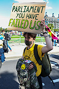 A demonstrator holds a poster at Parliament Square during an Extinction Rebellion climate change protest in London, Tuesday, Sept 1, 2020. (VXP Photo/ Vudi Xhymshiti)