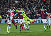 Football - 2017 / 2018 Premier League - West Ham United vs Stoke City<br /> <br /> Desperate defending from West Ham as Joe Hart (West Ham United) punches clear as Stike City pile on the pressure at the London Stadium<br /> <br /> COLORSPORT/DANIEL BEARHAM
