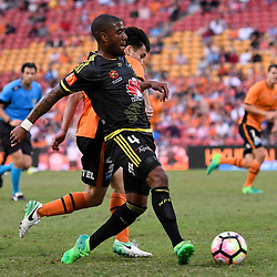 BRISBANE, AUSTRALIA - APRIL 16: Joe Caletti of the Roar and Roly Bonevacia of the Phoenix compete for the ball during the round 27 Hyundai A-League match between the Brisbane Roar and Wellington Phoenix at Suncorp Stadium on April 16, 2017 in Brisbane, Australia. (Photo by Patrick Kearney/Brisbane Roar)