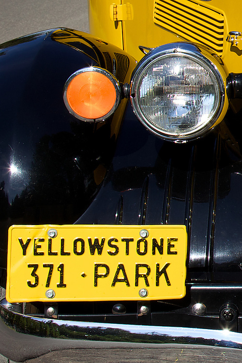 One of several refurbished White Model 706 touring buses operating in Yellowstone National Park today. These historic Yellow Tour Buses were originally used in the park during the 1930s, replacing stagecoach travel.