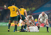 Twickenham, Great Britain, Joe LAUNCHBURY, lays the ball back for Owen FARRELL to play, as left Tom Wood and Dan COLE, gaurd,  during the Pool A game, England vs Australia.  2015 Rugby World Cup, Venue, RFU Stadium, Twickenham, Surrey, ENGLAND.  Saturday  03/10/2015<br /> Mandatory Credit; Peter Spurrier/Intersport-images]