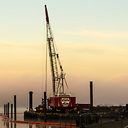 The day is just beginning and this crane creates a beautiful contrast towering above the Hudson river looking north west from Tarrytown, NJ