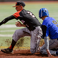 The throw to Gallup Bengal Tyler Sanchez (2) bounces in the dirt as Bloomfield Bobcat Damian Sanchez (9) slides into second base Tuesday at Ford Canyon Park.