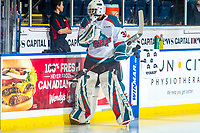 KELOWNA, CANADA - DECEMBER 29: Roman Basran #30 of the Kelowna Rockets clears the pucks from the bench for warm up against the Kamloops Blazers on December 29, 2018 at Prospera Place in Kelowna, British Columbia, Canada.  (Photo by Marissa Baecker/Shoot the Breeze)