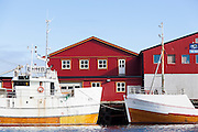 Detail of commercial fishing boats and warehouses in Sorland, Vaeroy Island, Lofoten Islands, Norway.