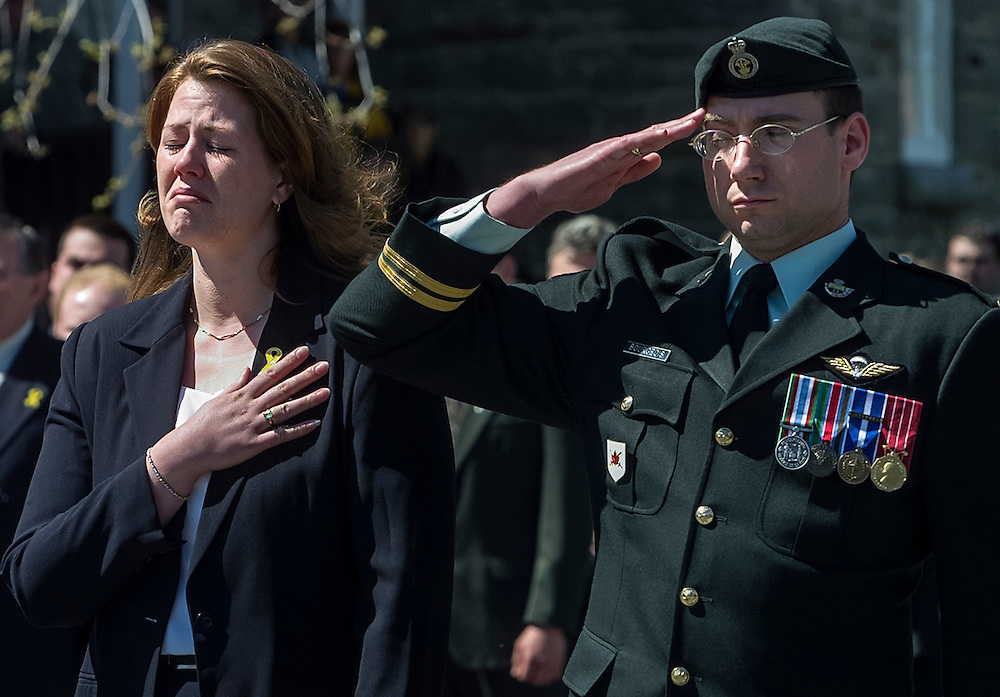 Widow Marley Leger (L), wife of Canadian<br /> soldier Sgt. Marc Leger, cries at a funeral for her husband in<br /> Lancaster, Ontario, April 24, 2002. REUTERS/Jim Young