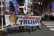 """Japanese people hold a banner calling for Four More Years of the Trump presidency as several hundred people, waving flags and banners, take part in a """"March For Trump"""" rally  in support of the out-going United States President, Donald Trump. Tokyo, Japan. Wednesday January 6th 2021. The rally of mostly Japanese people took place as part of a similar rally by Trump-supporters in Washington DC as the results of the 2020 US Presidential election were confirmed."""