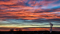 Colorful Dawn Clouds Over Boulder. Image taken with a Nikon D300 camera and 18-200 mm VR lens (ISO 450, 38 mm, f/8, 1/125 sec).