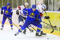 Yevgeniy Fadeyev of Kazakhstan vs ROK LEBER of Slovenia during Friendly Ice-hockey match between National teams of Slovenia and Kazakhstan on April 9, 2013 in Ice Arena Tabor, Maribor, Slovenia.  (Photo By Vid Ponikvar / Sportida)