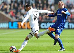 Martin Olsson of Swansea City under pressure from Wayne Rooney of Everton- Mandatory by-line: Nizaam Jones/JMP - 14/04/2018 - FOOTBALL - Liberty Stadium - Swansea, Wales - Swansea City v Everton - Premier League