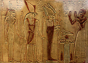 Painted stele of the priest Pu-Inpu, priest of Horus. 26th Dynasty (approx. 600 BC) Egyptian from Abydos. Made of limestone with traces of polychrome colouring. Showing the deceased worshipping Osiris, Hornedjitef and Isis.