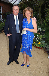 The DUKE & DUCHESS OF RUTLAND at the annual Cartier Flower Show Diner held at The Physics Garden, Chelsea, London on 23rd May 2005.<br />