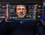 Jason Meyers, Associate Professor of Biology and Neuroscience holds a tank of zebra fish November 6, 2019.