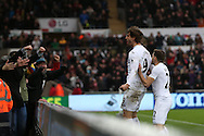 Fernando Llorente of Swansea city (l) celebrates with Angel Rangel after he scores his teams 3rd goal to make it 3-2.   Premier league match, Swansea city v Burnley at the Liberty Stadium in Swansea, South Wales on Saturday 4th March 2017.<br /> pic by Andrew Orchard, Andrew Orchard sports photography.