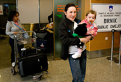 Slovenian biathlon athlete Dijana Ravnikar with her daughter Mija at arrival to Airport Joze Pucnik from Vancouver after Winter Olympic games 2010, on February 26, 2010 in Brnik, Slovenia. (Photo by Vid Ponikvar / Sportida)