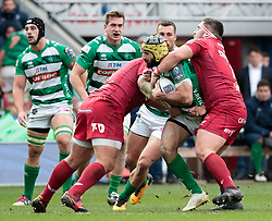 Benetton Rugby's Angelo Esposito under pressure from Scarlets' Wyn Jones<br /> <br /> Photographer Simon King/Replay Images<br /> <br /> EPCR Champions Cup Round 3 - Scarlets v Benetton Rugby - Saturday 9th December 2017 - Parc y Scarlets - Llanelli<br /> <br /> World Copyright © 2017 Replay Images. All rights reserved. info@replayimages.co.uk - www.replayimages.co.uk