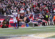 Julian Edelman scores a 32-yard touchdown on fourth-and-four after landing on two Bills defenders, rolling off them and continuing to run to the end zone.