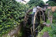 Derelict waterwheel at a mill building in Hartlebury, England, United Kingdom.