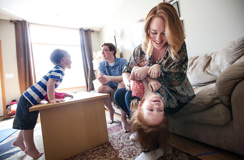 Claire Nielsen and her husband Drew Nielsen play with their children Abbey, 4, and Tyler, 3, at their home in Maple Grove, MN, June 9, 2015. Claire carried twins as a gestational surrogate for a California couple and gave birth to them in December.