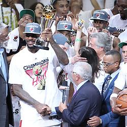 Jun 21, 2012; Miami, FL, USA; NBA commissioner David Stern presents the MVP trophy to Miami Heat small forward LeBron James after winning the 2012 NBA championship at the American Airlines Arena. Miami won 121-106. Mandatory Credit: Derick E. Hingle-US PRESSWIRE