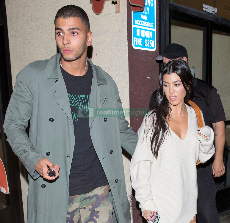 Kourtney Kardashian and her new model boyfriend Younes Bendjima were seen leaving sister Kim's 37th Birthday family and friends dinner at the 'Carousel' Lebanese and Armenian Restaurant in Los Feliz, CA. 26 Oct 2017 Pictured: Younes Bendjima, Kourtney Kardashian. Photo credit: MEGA TheMegaAgency.com +1 888 505 6342