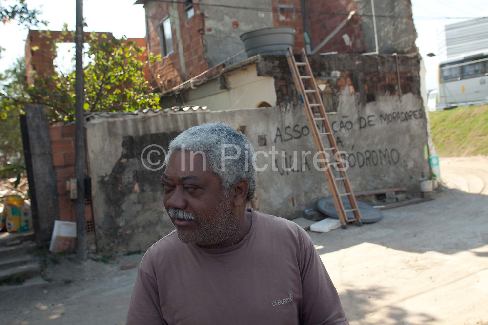 Augusto Periera takes out his final belongings before his home is demolished. His house is one of the last standing of the original homes, is demolished today. Vila Autodromo favela, in the west zone of Rio, is in direct site of the Rio 2016 Olympic park. There has been an ongoing struggle between residents and the City Government of Eduardo Paes. After a long battle, 20 families who held on were allowed to stay, on the provision that they moved into houses constructed by the state, in the same style as the public housing programme.