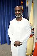September 19, 2012- Queens, New York:  Former Prisoner Tamsir Jasseh poses for photograph as a free man after being held as a prisoner in the Gambia, West Africa. Former Prisoner Amadou Scattred Janneh, a former Professor at the University of Tennessee, who held dual US Citizenship with the Gambia, was serving a life sentence for Treason. In addition to him, Tamsir Jessah, a U.S Citizen and former U.S. Military Veteran with dual citizenship with the West African nation was also serving a twenty-year sentence for Treason. With a face-to-face appeal by Rev. Jesse L. Jackson, with the Yayha Jammeh, President of The Gambia an agreement was made to release the two American citizens into Rev. Jackson's custody who allow them to return to the United States with Jackson Tuesday night.  The two men returned to the U.S. by plane with Rev. Jackson from The Gambia to joyfully grateful waiting family members. In addition, President Jammeh has agreed to extend the moritorium on executions indefinitely, marking a significant gain for Human Rights in the West African Nation on September 19, 2012. (Terrence Jennings)