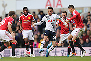 Dele Alli of Tottenham Hotspur (c) with the ball while being marked by Juan Mata of Manchester United, Chris Smalling of Manchester United and Michael Carrick of Manchester United.Barclays Premier league match, Tottenham Hotspur v Manchester Utd at White Hart Lane in London on Sunday 10th April 2016.<br /> pic by John Patrick Fletcher, Andrew Orchard sports photography.