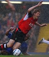 Photo. Daniel Hambury.<br /> Barclays Premiership.<br /> Chelsea v Blackburn Rovers. 23/10/2004.<br /> Chelsea's Glen Johnson brings down Blackburn Rovers' Jonathan Stead