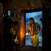 Muni Baba, or Silent Baba, enters his humble home at Tapovan, Gangotri Glacier, Uttarakhand, India. Having taken a vow of silence, Muni Baba has not spoken a word in more than ten years.