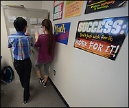 """A  """"Day in the life of Suraj Modi""""  student at Twin Rivers Middle School on May 19, 2015 in Buford, Georgia.  (LEFT TO RIGHT)    Suraj Modi and Andreea Juravschi  work on a math problem in class. Johnny Crawford/SPECIAL"""