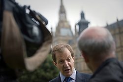 © licensed to London News Pictures. 19/07/2011. London, UK.  Alastair Campbell talking to TV on College Green outside the Houses of Parliament in London today (19/07/2011) before Rebekah Brooks and Rupert Murdoch give evidence to the Culture, Media and Sport Committee in relation to the News Of The World phone hacking scandal. Photo credit should read Ben Cawthra/LNP