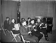 20/03/1959<br /> 03/20/1959<br /> 20 March 1959<br /> Gael Linn singing competition and concert at Dungannon, Co. Tyrone. <br /> Image shows a group of musicians playing at the concert in St. Patrick's Hall.